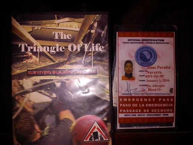 Jesus Peralta, ARTI (American Rescue Team International) Badge and a copy of The Triangle of Life video used to train, in Ilo.