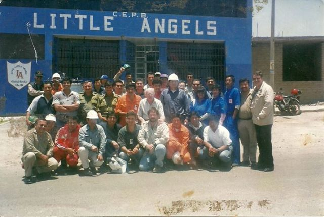 "Members of the Ilo Rescue Team, in front of the Chisholm Family School; ""Little Angels'."