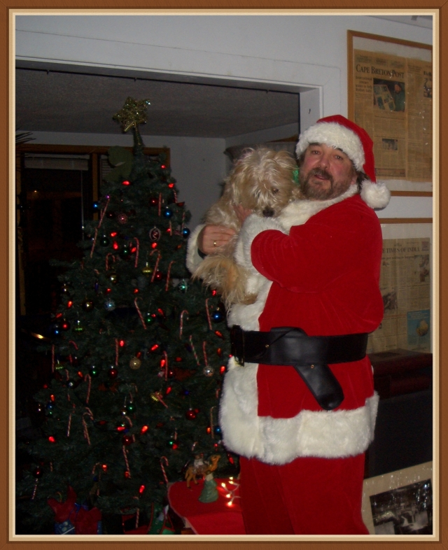 Santa brings presents to little boys and girls and to Good Doggies, too!