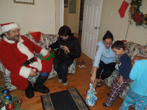 Mrs Claus helps Santa deliver presents to good little boys and girls.